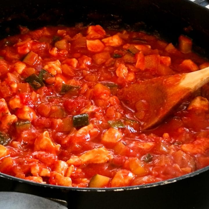 Spaghetti sauce with chicken in a pan