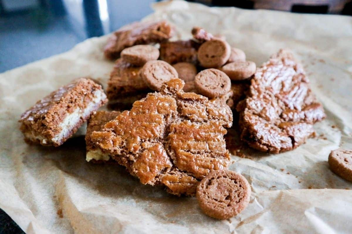 A mix with pepernoten, speculaas and speculaas with almond paste on a piece of paper